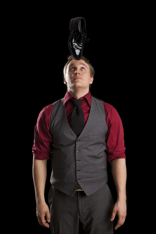 Juggler-magician Lauri Tuhkanen balancing shoe on head
